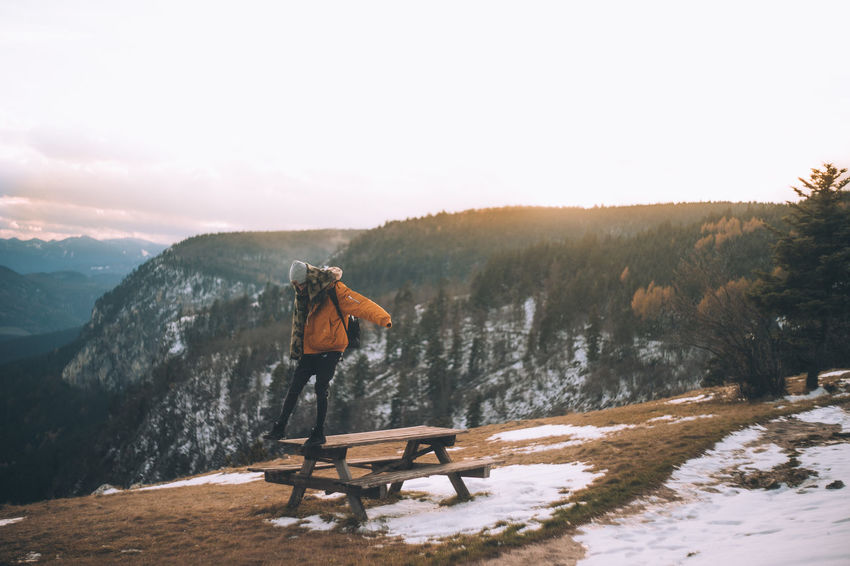 Adventure Beauty In Nature Cold Temperature Day Frozen Full Length Hiking Landscape Leisure Activity Men Mountain Mountain Range Nature One Person Outdoors Real People Rear View Scenics Sky Snow Standing Tranquil Scene Warm Clothing Weather Winter
