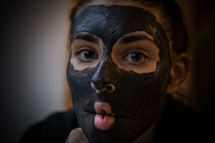 Close-Up Portrait Of Young Woman With Facial Mask