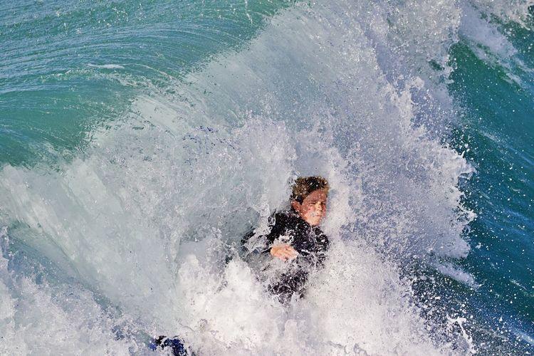 High angle view of man splashing water