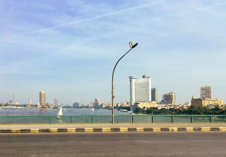 Cairo Cairo Tower Nile River Riverside Architecture Bird Building Exterior Built Structure Cityscape Day Modern No People Outdoors River Road Sea Sky Skyline Skyscraper Tall Travel Destinations Urban Scene Urban Skyline Water Waterfront