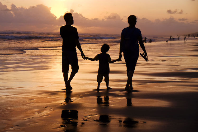 Enjoy the sunset with family on the beach Family Holiday Parangtritis Yogyakarta, Indonesia Beach Beauty In Nature Child Family Time Group Of People Indonesia Photography  Land Lifestyles Orange Color Real People Sea Silhouette Sky Sunset Tourism Travel Destinations Water Women