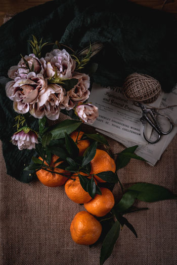 High angle view of orange flower on table