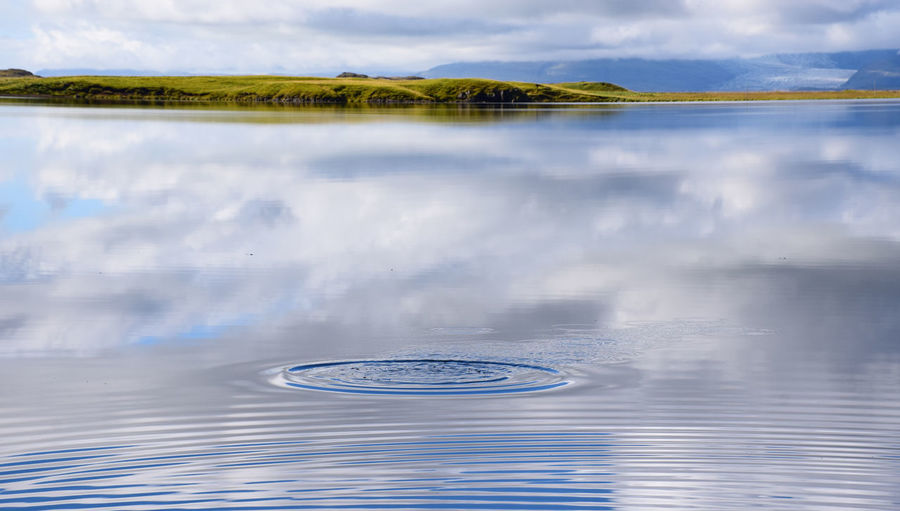 Reflection in Iceland Beauty In Nature Day Floating On Water Iceland Lake Lake View Nature No People Outdoors Reflection Reflection Sky Water