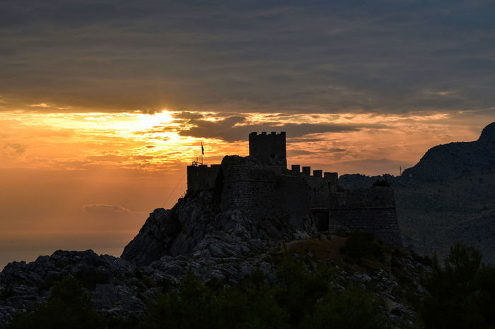 Sunset at Strigrad Fort, Omis, Croatia Sunset Architecture Built Structure Cloud - Sky Sky Scenics Orange Color Beauty In Nature Nature Castle Outdoors Tranquility Dramatic Sky History Medieval Cliff Croatia Croatia_photography Omis Croatia Old Buildings Europe Castle Sunset_collection