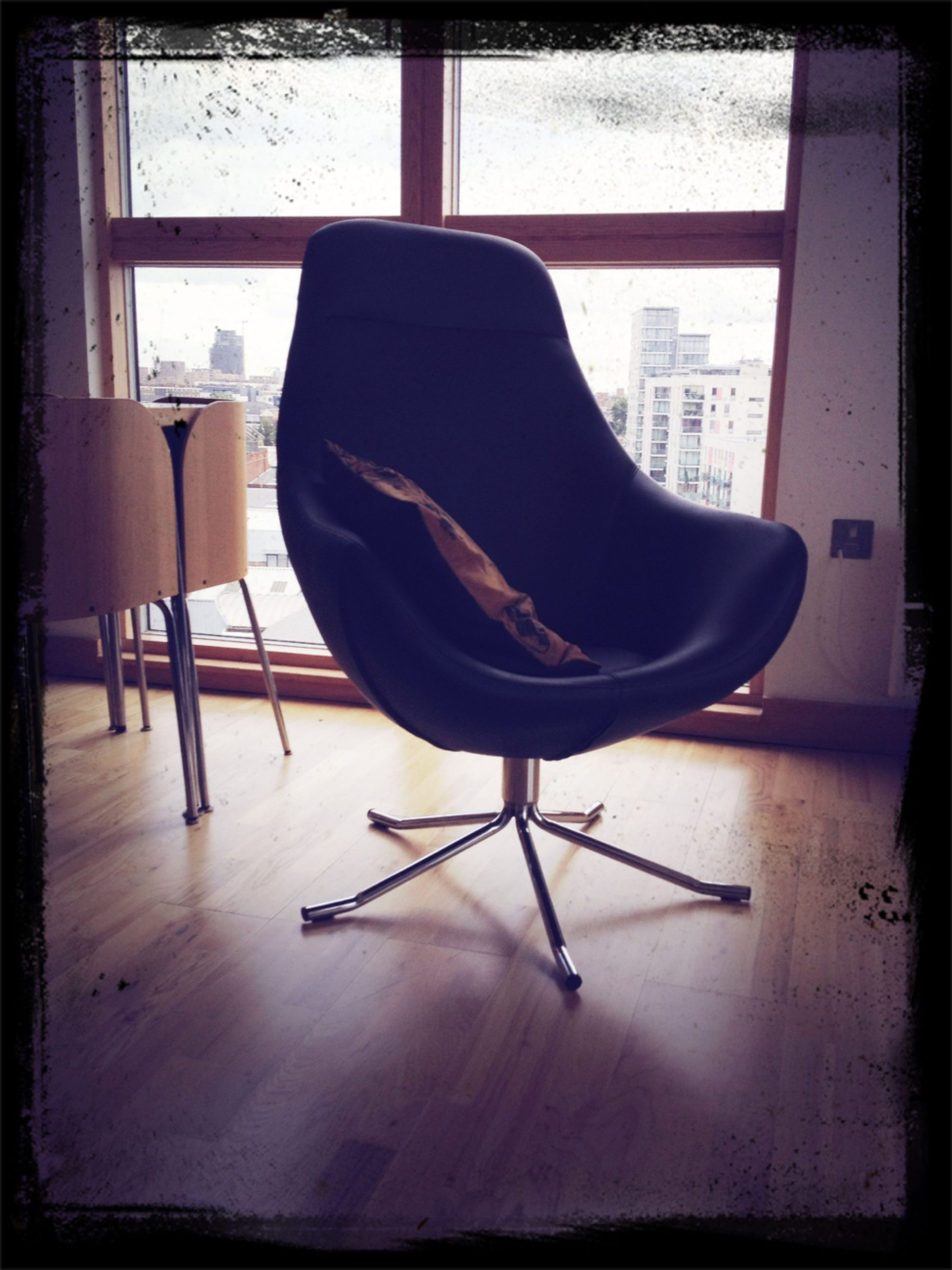 indoors, chair, home interior, window, sitting, relaxation, table, domestic room, absence, empty, transfer print, sofa, living room, domestic life, furniture, auto post production filter, flooring, one person, bed, full length