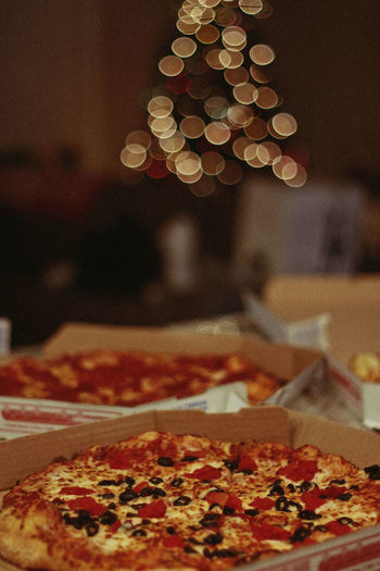 Holidays, 2018 Pizza Food Food And Drink Indoors  Still Life Freshness Unhealthy Eating Focus On Foreground Ready-to-eat No People Close-up Italian Food Table Cheese Dairy Product Business Restaurant Selective Focus Pepperoni Snack Pepperoni Pizza Temptation Bokeh Holidays Christmas