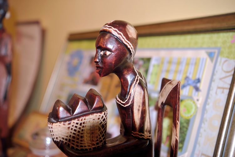 Mom's Figurines 4 African Art African Female Still Life Photography Still Life Collectibles Figurine  Wooden Statuettes Hand Carved Traditional Dress Holding Basket Seated Chair For Arts Sake Symbols Of Human Culture Abstract Photography Abstract Close-up Framed Collage