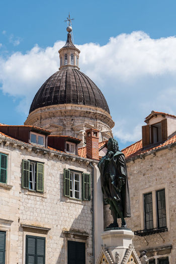 Dubrovnik Cathedral, Dubrovnik, Croatia Architecture Building Exterior Built Structure Cloud - Sky Croatia Day Dome Dubrovnik Dubrovnik Cathedral Ivan Gundulic Ivan Gundulic Statue Low Angle View No People Outdoors Place Of Worship Religion Sculpture Sky Spirituality Statue Travel Destinations