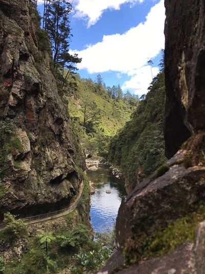 View of stream flowing through mountain