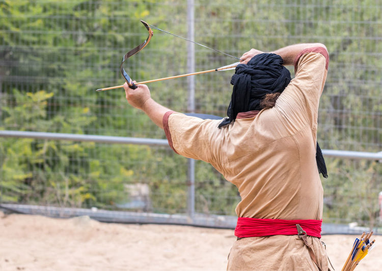 "Jerusalem, Israel, September 30, 2018 : The participants of the festival in traditional costume of the Saracen warrior show the art of archery at the annual festival ""Jerusalem Knights"" Business Fun International Jerusalem Israel Jerusalem Knights Saracen Show Warrior Advertisement Art Battle Design Exhibition Festival Fighter Friendship Game Magician Medieval Samurai Spectator Symbol Traditional Costume Triumph Watching"