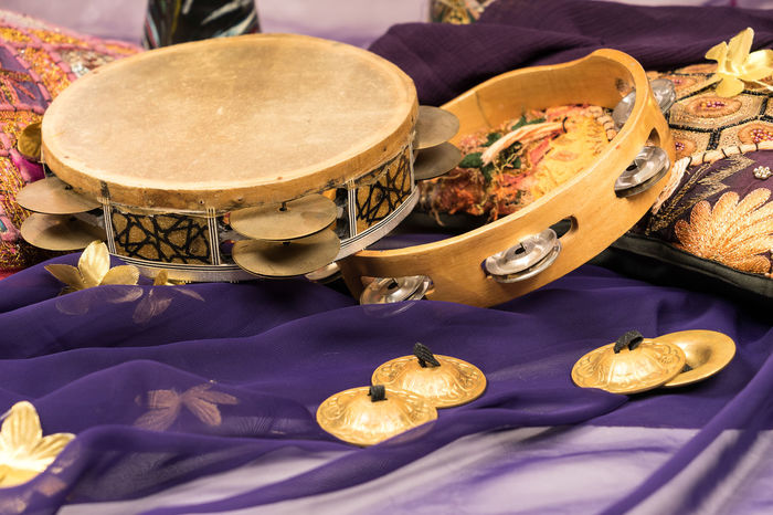 musical instruments of a bellydance percussiongroup with darbuka's, tambourines and zills Arabic Music Celebration Golden Making Music Objects Ornament Arabic Style Bellydance Close-up Cultural Diversity Cymbal Darbuka Decoration Drums Festive Flower Musical Instrument No People Party Percussion Purple Color Tambourine Togetherness Tomtom Traditional