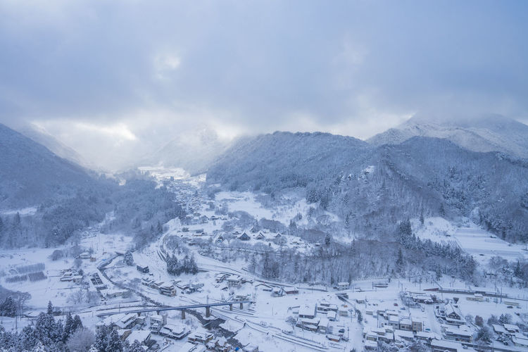 Winter Cold Temperature Snow Mountain Landscape Cloud - Sky Environment Scenics - Nature Sky Nature No People Beauty In Nature Travel City Mountain Range Tranquil Scene Journey Outdoors Day Snowcapped Mountain Range Snowing