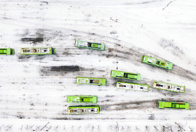 Aerial view of buses on snow covered road