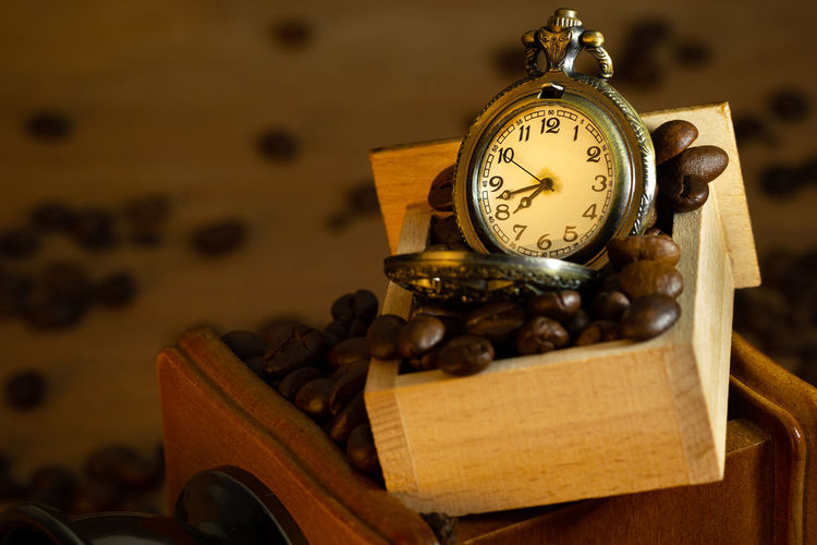 Close-up of old clock on table