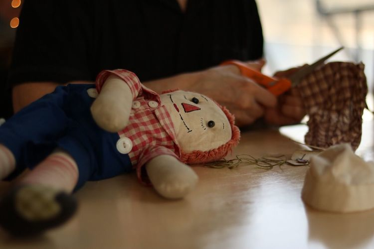 Mending Andy Scissors Sewing Patching Mending Raggedy Andy One Person Indoors  Toy Close-up Stuffed Toy Art And Craft