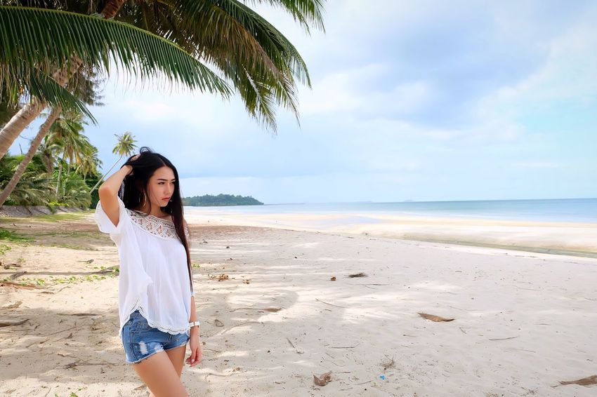 Women on the beach Beach Sea Sky Land Water One Person Sand Beauty In Nature Leisure Activity Horizon Over Water Horizon Nature Scenics - Nature Women Real People Day Standing Front View Lifestyles Fashion