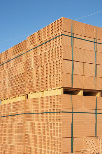 brick for wall Blocks Constrction New Partition Wall Brick Brown Building Clay Color Concept Constructed Constructing Material Pallet Solid Warehouse