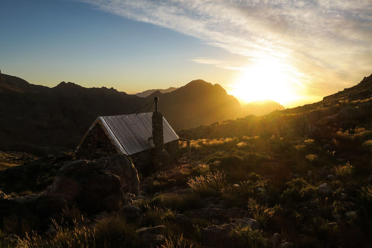 Sun setting over secluded mountain cabin Beauty In Nature Cabin Explore Grass House Hut Landscape Let's Go. Together. Mountain Mountain Range Nature No People Outdoor Outdoor Photography Outdoors Secluded  Sky Sun Sunset Sunset_collection Tranquility Travel