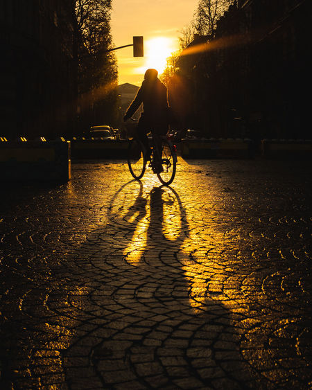 Bicycle Transportation Sunset Mode Of Transportation Land Vehicle City Street Ride Riding Sunlight Sky Real People One Person Lifestyles Nature Shadow Cycling Architecture Activity Cobblestone Outdoors Paving Stone Lens Flare Golden Hour Streetphotography Streetwise Photography