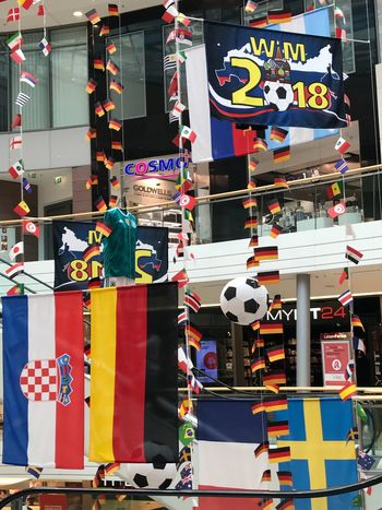 Football is coming home ? AMP PICTURES Market Multi Colored No People Retail  Choice Architecture Variation Store Day Business Market Stall City For Sale Built Structure Building Exterior Sale Collection Shopping