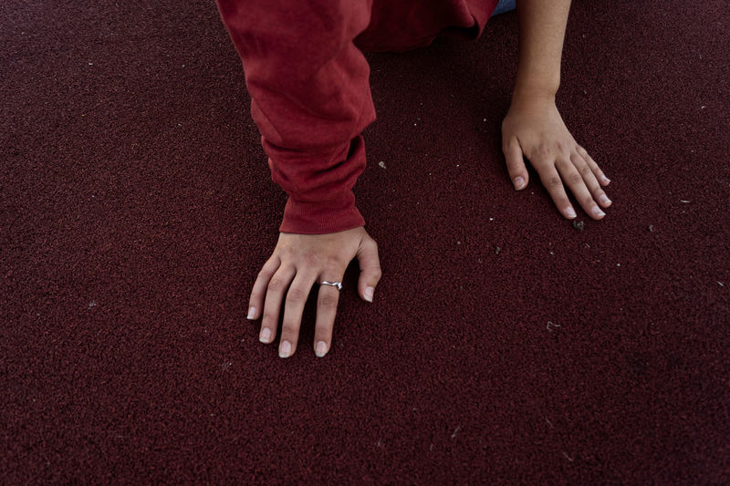 High angle view of woman hands on sports track