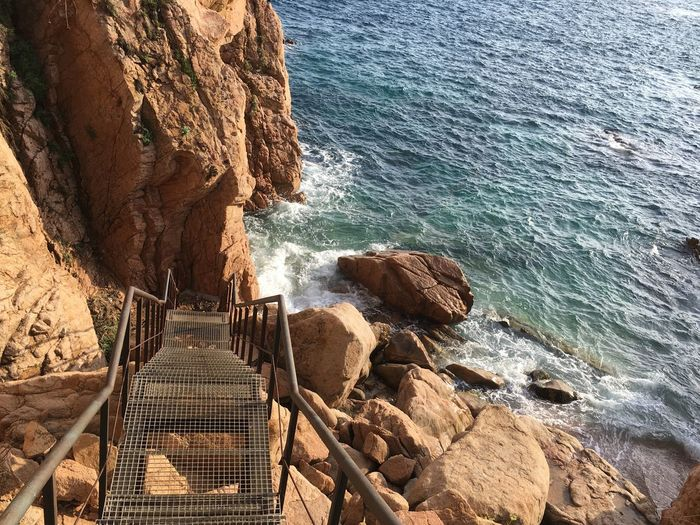 Staircase Perspective Staircase Water Sea Rock Sunlight Nature Day Beach Solid Rock - Object Land High Angle View No People Tranquility Beauty In Nature Motion Outdoors Wave Scenics - Nature Tranquil Scene