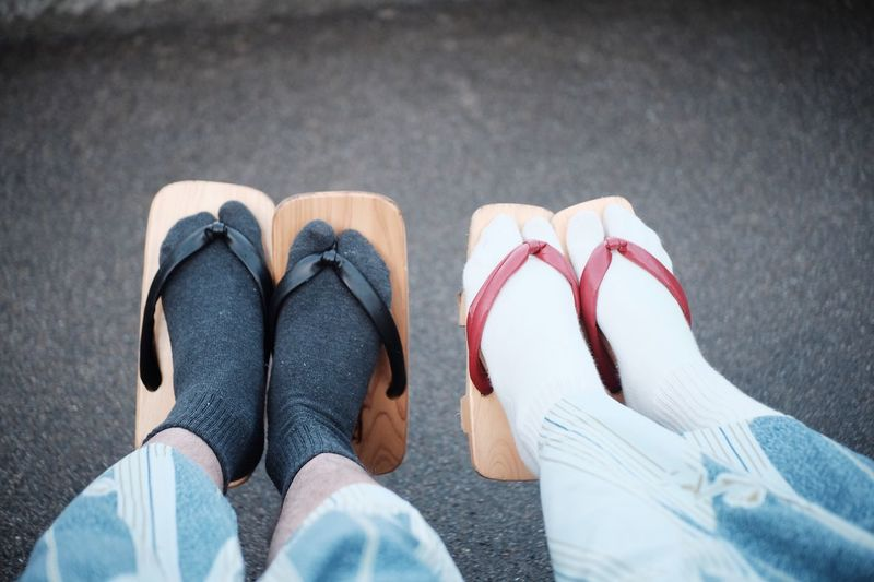 Low Section Of People Wearing Geta