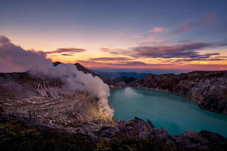 Idyllic Shot Of Smoke Emitting From Ijen Volcano Against Sky During Sunrise