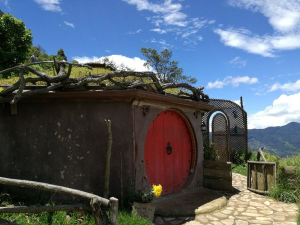 Hobbitenango Guatemala Guatemala View Little House On The Prairie Little House In The Mountains Red Red Door And Green Door Red Color Sky And Clouds Green Color Gate Door Sky Outdoors No People Nature Architecture Mountains And Sky Outdoors Photography Green Grass Guatemala Secrets Mountains And Clouds Mountain View Guatemala's Sky Clouds Collection