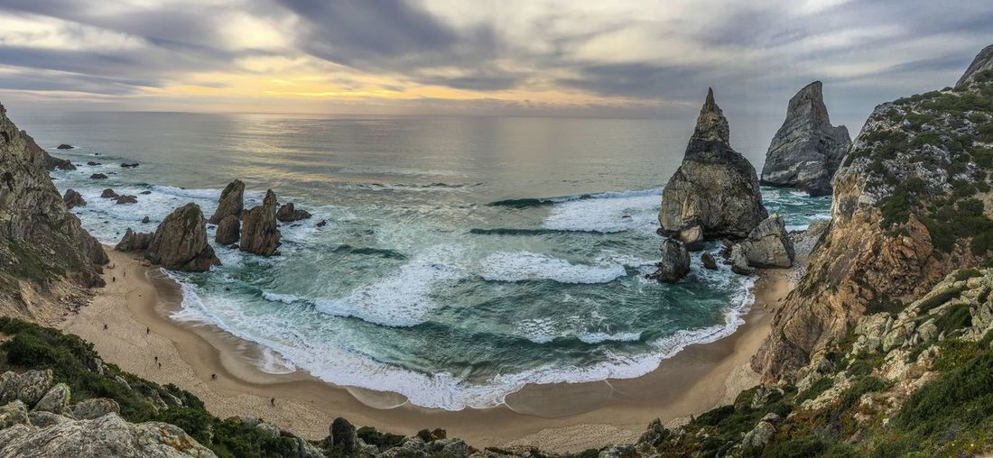 Beach Beauty In Nature Cliff Cloud - Sky Day EyeEmNewHere Horizon Over Water Mountain Nature No People Outdoors Panorama Portugal Rock - Object Rock Formation Scenics Sea Sky Sunset Tranquil Scene Tranquility Travel Destinations Ursa Beach Water Let's Go. Together.