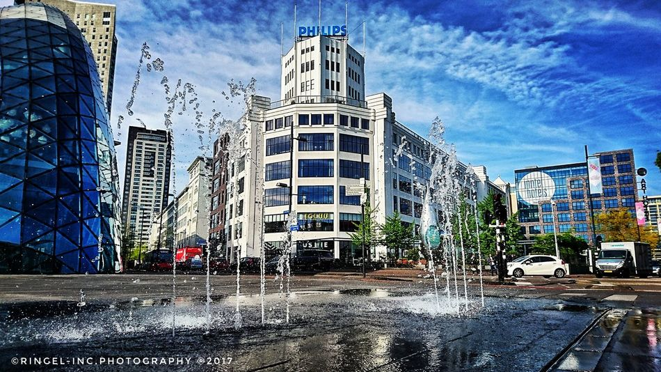 Down town Eindhoven. Architecture Sky Built Structure Day Cloud - Sky Building Exterior Outdoors Wet City No People Modern Skyscraper Water