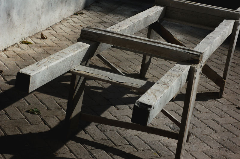 High angle view of empty bench on table