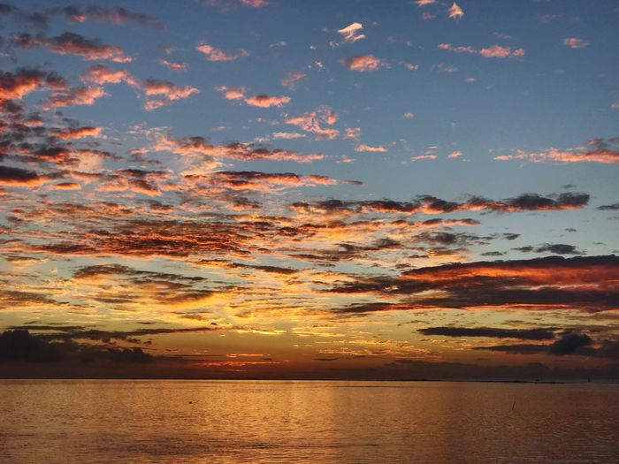 Sunset Water Sky Beauty In Nature Scenics - Nature Sea Tranquility Tranquil Scene Idyllic Orange Color Nature No People Reflection Dramatic Sky Horizon Over Water Romantic Sky Waterfront Cloud - Sky Horizon Outdoors