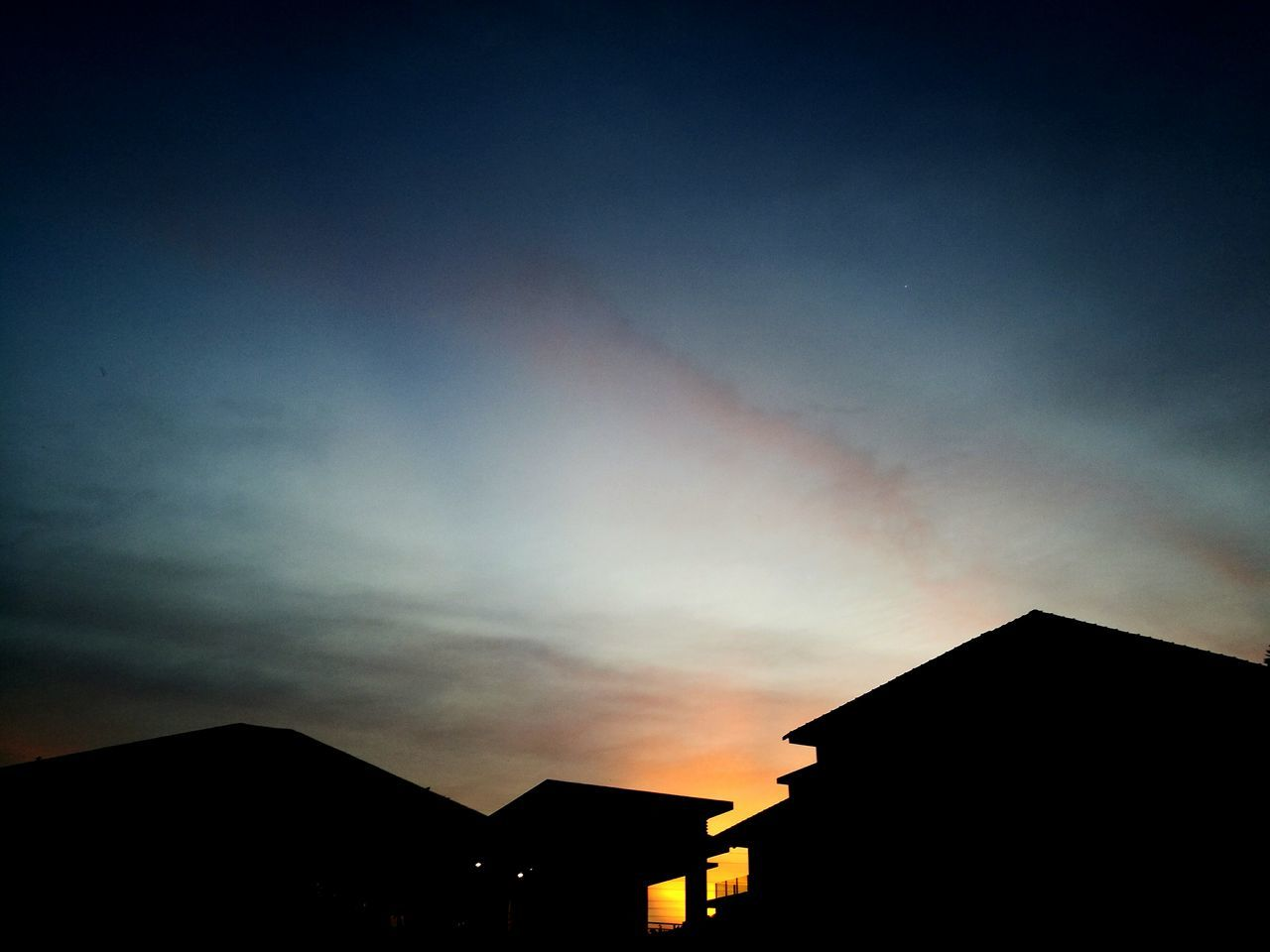 built structure, silhouette, building exterior, architecture, sky, sunset, house, no people, low angle view, outdoors, cloud - sky, roof, beauty in nature, nature, scenics, day