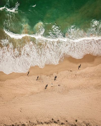 Who's up for beach today. Land Beach Water Sand Beauty In Nature Nature Day Sea Tranquility Motion High Angle View Outdoors Wave Non-urban Scene Tranquil Scene Sunlight Scenics - Nature