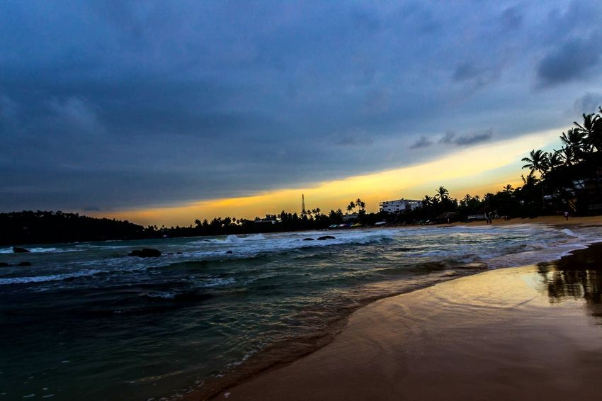 Travel Destinations Beach Sea Sunset Scenics Dramatic Sky Beauty In Nature No People Outdoors Sand Tree Day Mirissabeach