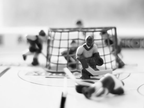Jason smirked, the new Swedish defense strategy really kept the Finnish players off balance... Sport Playing Large Group Of People Only Men Men Outdoors Sports Team Sports Uniform Adult People Match - Sport Adults Only Day Table Hockey Table Game Bokeh Photography Shallow Depth Of Field Monochrome Black & White Black And White Game