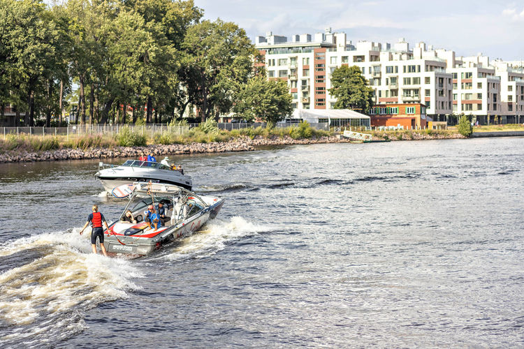 People riding boat in river