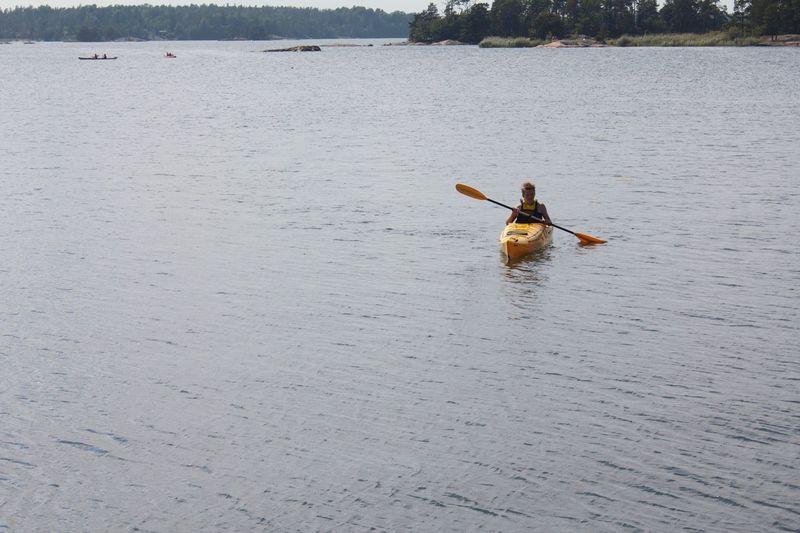 Teenage boy boating on river