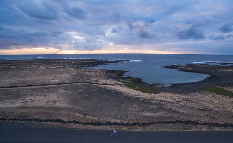 fuerteventura canarian islands spain drone aerial corralejo girl on road desert walking vulcano skate lighthouse sunset skate DJI Mavic Pro Fuerteventura Wanderlust Aboutpassion Aerial View Beach Beauty In Nature Cloud - Sky Coastline Dronephotography Holiday Horizon Horizon Over Water Land Nature Outdoors People Sand Scenics - Nature Sea Sky Tranquility Travel Destinations Vanlife Water