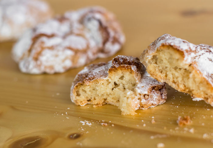 Traditional Sicilian dessert. Sicilian almond pastries on wooden table. Defocused blurry background. Breakfast Cooking Cuisine Dessert Eating Mediterranean  Rustic Sicilia Snack South Almonds Background Biscuit Bitten Brown Candy Close-up Crumbs Delicious Food Italian Italy Macro Pastry Reale