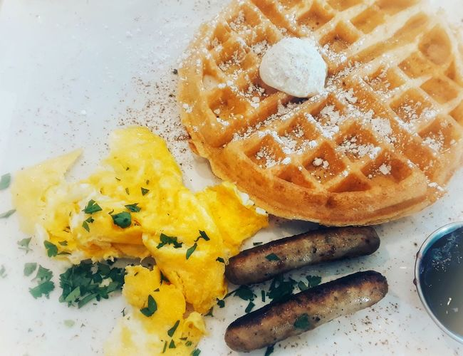 An airy Belgian waffle with scrambled eggs and two turkey sausage Breakfast Bread Cafe Tasty Delicious Meal EyeEmNewHere Food And Drink No People Indoors  Food Close-up Freshness Day