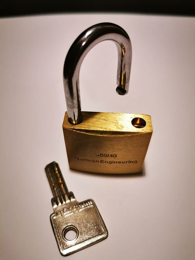 Close-up of padlocks against white background