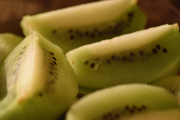 Close-Up Of Kiwi Slices