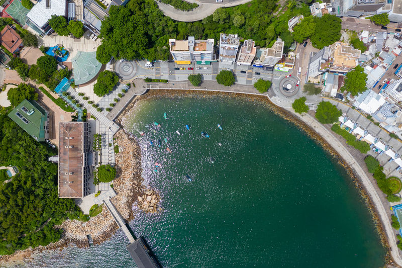 High angle view of swimming pool amidst buildings in city