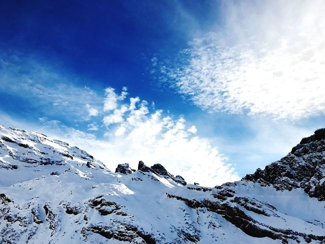 Snow Winter Cold Temperature Sky Weather Nature Beauty In Nature Scenics Mountain Tranquility Snowcapped Mountain White Color Non-urban Scene Blue Tranquil Scene Outdoors Sunlight Day Cloud - Sky Adventure