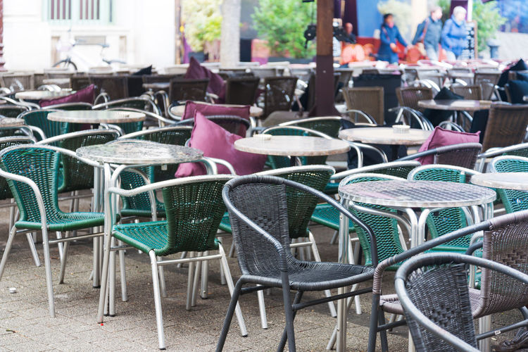 Travel Destinations Travel Chair Seat Absence Cafe Day Table Empty Furniture Business No People Restaurant Arrangement In A Row Outdoors Architecture Order Large Group Of Objects Sidewalk Cafe Focus On Foreground Setting Coffee Shop Luxury