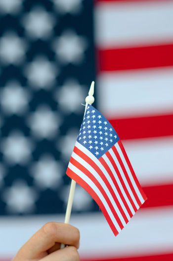 USA flag Flag Patriotism Red Star Shape Shape Holding Striped One Person Pride Focus On Foreground Human Hand Hand Close-up Human Body Part Independence Freedom Symbolism National Icon Government Finger Democracy