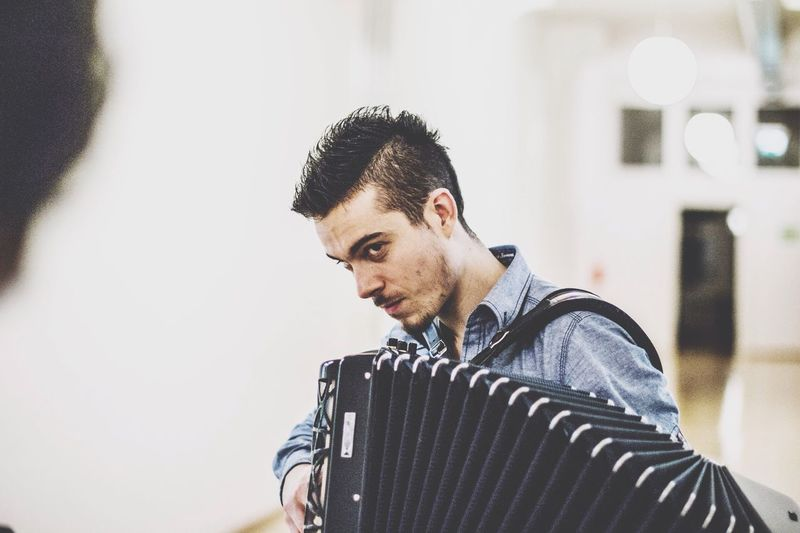 Young Man Playing Accordion