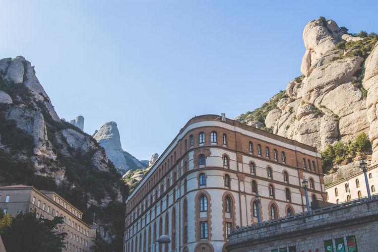 Low Angle View Of Buildings Against Sky At Santa Maria De Montserrat Abbey